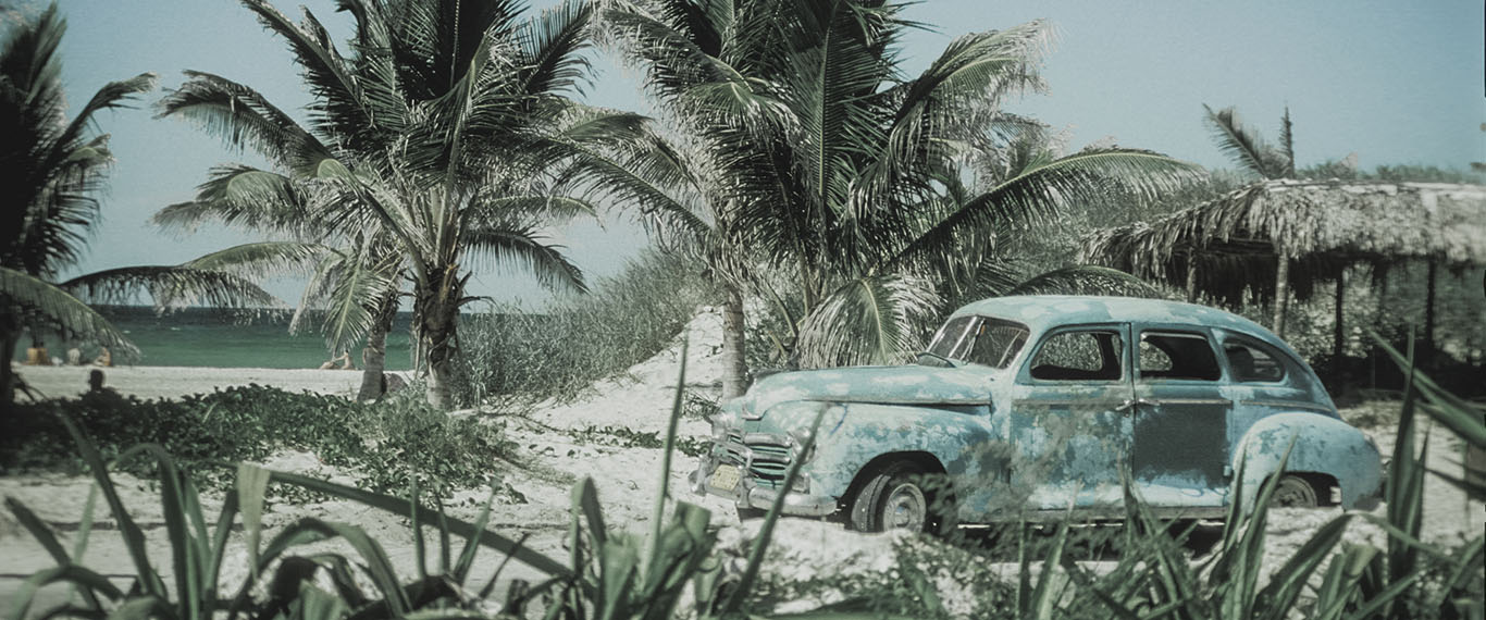 Vintage car at the beach in Cuba